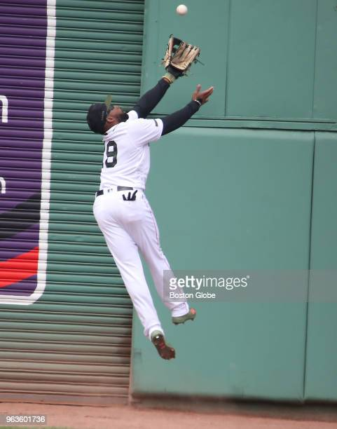 Boston Red Sox player Jackie Bradley Jr robs Toronto Blue Jays' Kendrys Morales of an extra base hit with a catch during the sixth inning The Boston...