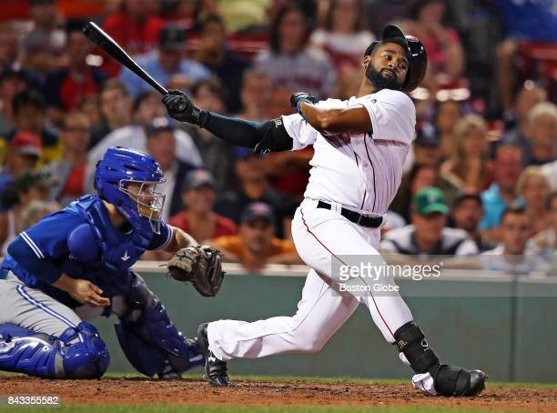 Boston Red Sox player Jackie Bradley Jr swings and misses for strike three in the bottom of the 12th inning The Boston Red Sox host the Toronto Blue...
