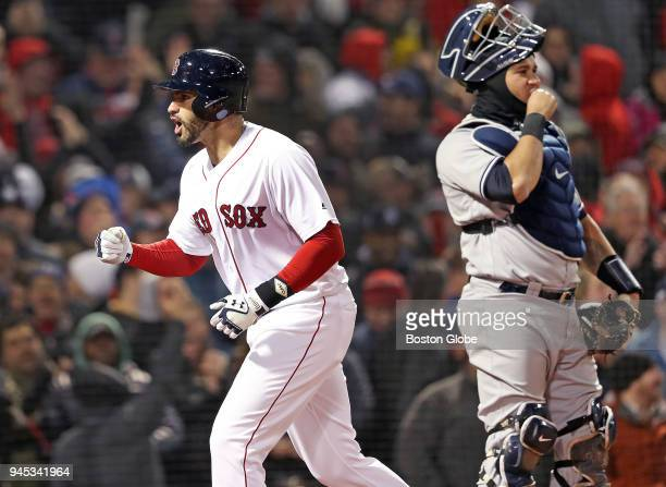 Boston Red Sox player JD Martinez left and Yankees catcher Gary Sanchez right have different reactions as Martinez crosses the plate following his...