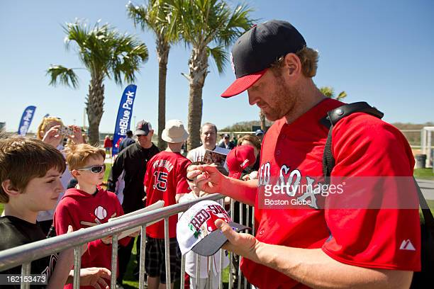 Boston Red Sox player Lyle Overbay signs his autograph for fans during spring training at JetBlue Park on Monday Feb 18 2013