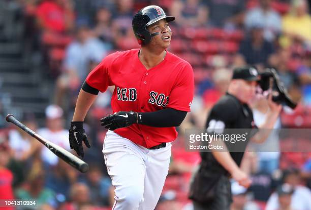 Boston Red Sox player Rafael Devers follows the flight of his bottom of the eighth inning home run his second of the game The Boston Red Sox host the...