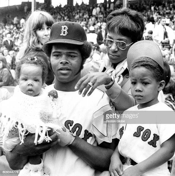 Boston Red Sox player Reggie Smith and his wife Ernestine are pictured with their children Nicole 4 months old and Reggie Jr during a game against...