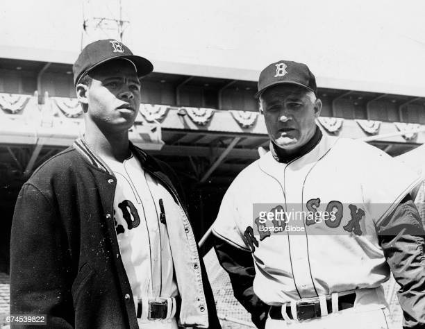 Boston Red Sox player Reggie Smith left and first base coach Bobby Doerr are pictured at Fenway Park in Boston on opening day of the 1967 Red Sox...