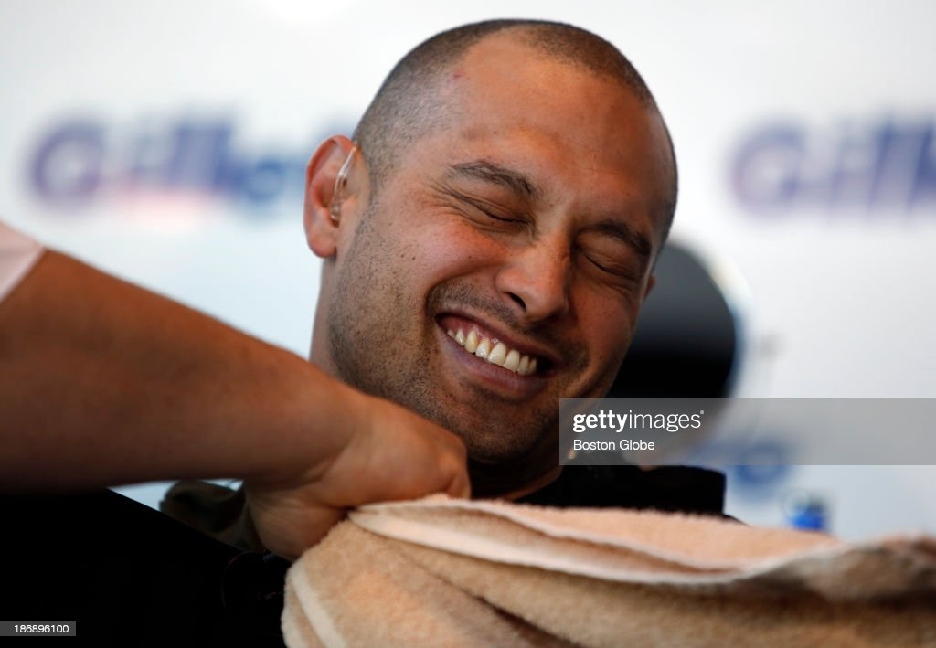 Boston Red Sox player Shane Victorino smiles after having his beard shaved off at Gillette World Shaving Headquarters in Boston on November 4, 2013. Gillette donated $100,000 to the One Fund Boston after the shave.