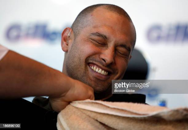 Boston Red Sox player Shane Victorino smiles after having his beard shaved off at Gillette World Shaving Headquarters in Boston on November 4 2013...