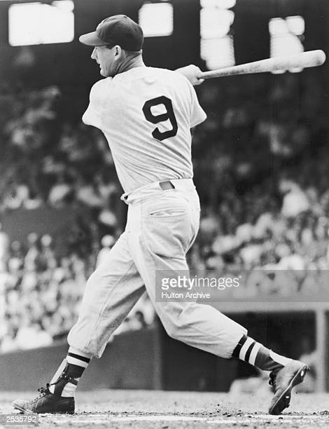 Boston Red Sox player Ted Williams swings at the plate during a game circa 1940
