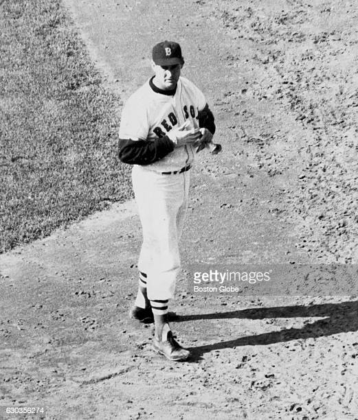 Boston Red Sox player Ted Williams walks from home plate after flying out to end the sixth inning during a game against the Detroit Tigers at Fenway...