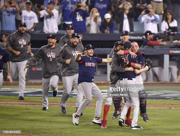 Boston Red Sox players celebrate their World Series victory after beating the Los Angeles Dodgers 51 in Game 5 at Dodger Stadium in Los Angeles on...