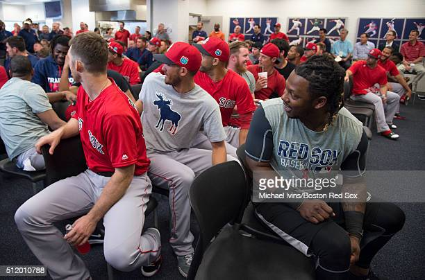 Boston Red Sox players including Hanley Ramirez right and Rick Porcello center participate in a team meeting during the first full team workout of...