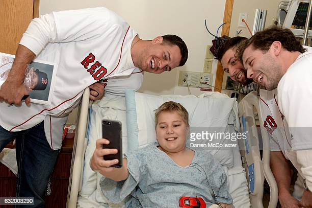 Boston Red Sox players Kyle Martin Sam Travis and Ben Taylor visit Harrison at Boston Children's Hospital on January 18 2017 in Boston Massachusetts