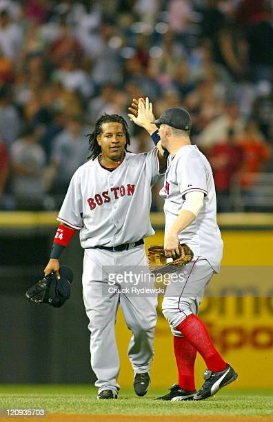 Boston Red Sox players Manny Ramirez and Trot Nixon celebrate their team's 30 win over the game against the Chicago White Sox July 23 2005 at US...