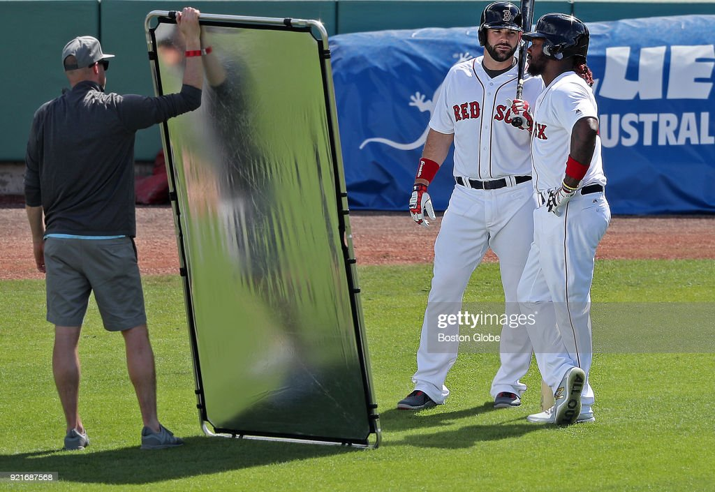 Boston Red Sox players Mitch Moreland, left, and Hanley Ramirez participate in a video shoot together on the main field after a spring training practice at Jet Blue Park in Fort Myers, FL on Feb. 20, 2018.