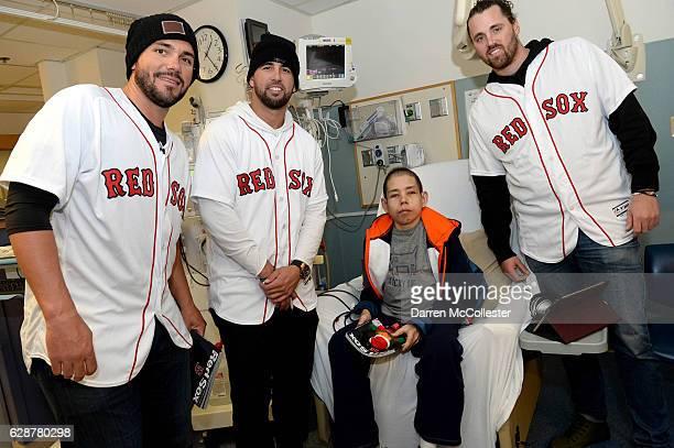 Boston Red Sox players Robby Scott Deven Marerro and Heath Hembree visit with Tyler at Boston Children's Hospital on December 9 2016 in Boston...