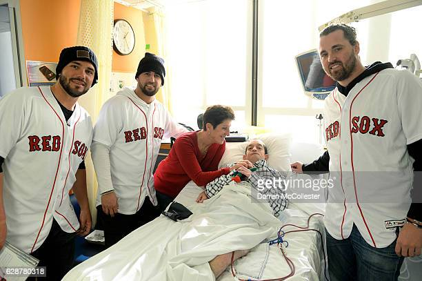 Boston Red Sox players Robby Scott Deven Marerro and Heath Hembree visit with Sean and Mom at Boston Children's Hospital on December 9 2016 in Boston...