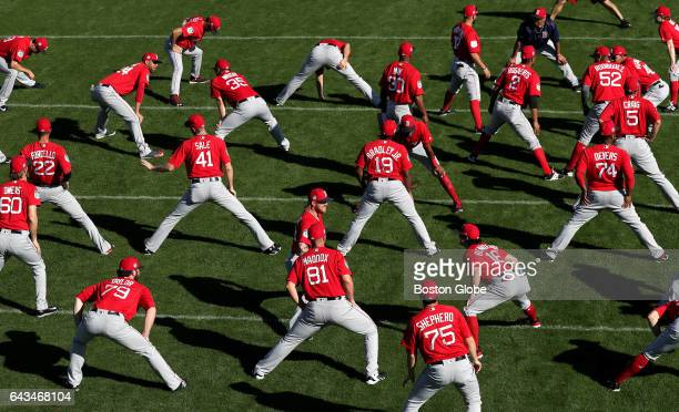 Boston Red Sox players stretch before practicing sliding drills on day eight of Red Sox Spring Training at Jet Blue Park in Fort Myers FL on Feb 20...