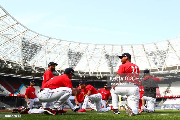 Boston Red Sox players take part in a team workoutk on the field during previews ahead of the MLB London Series games between Boston Red Sox and New...