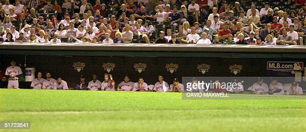 Boston Red Sox players watch from the bench during the eighth inning of their 8-3 loss to the Cleveland Indians on 28 August, 2001 at Jacobs Field in...