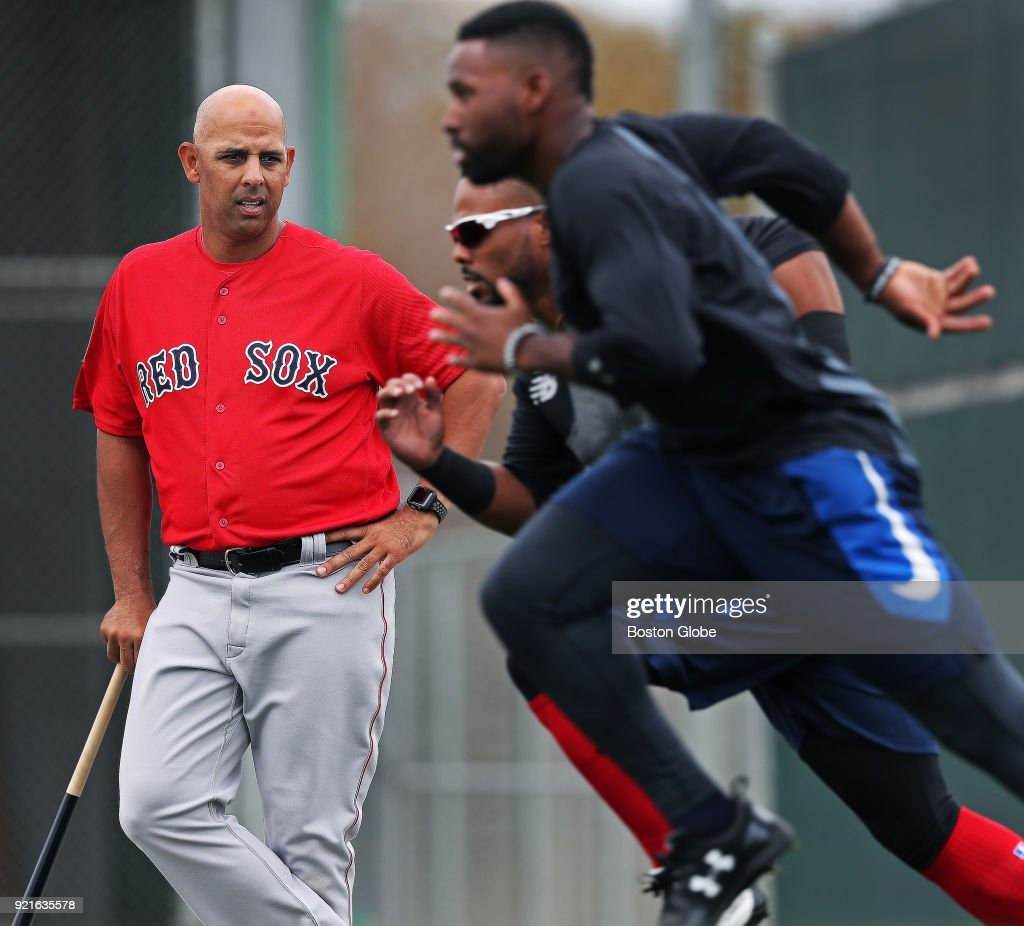 Boston Red Sox position players end the day with a set of wind sprints as manager Alex Cora watches from the sideline on the day of the first full squad spring training workout at the Player Development Complex at Jet Blue Park in Fort Myers, FL on Feb. 19, 2018.