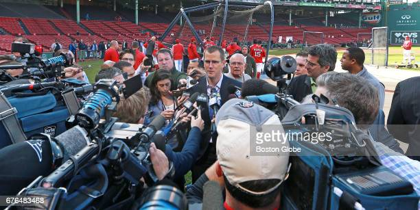 Boston Red Sox President and CEO Sam Kennedy answers questions from a large group of media on the field during batting practice The Boston Red Sox...