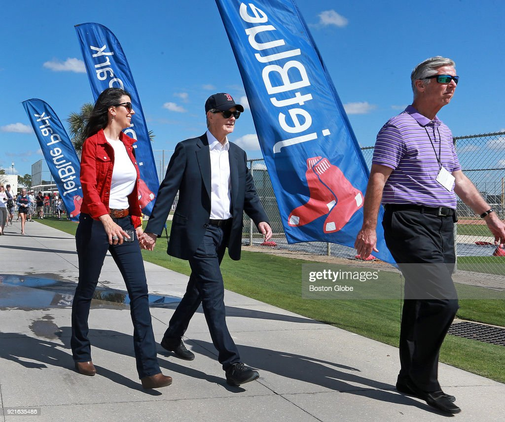 Boston Red Sox principal owner John Henry, center, his wife Linda Pizzuti Henry, left, and team president of baseball operations Dave Dombrowski, right, walk the grounds on the day of the first full squad spring training workout at the Player Development Complex at Jet Blue Park in Fort Myers, FL on Feb. 19, 2018.