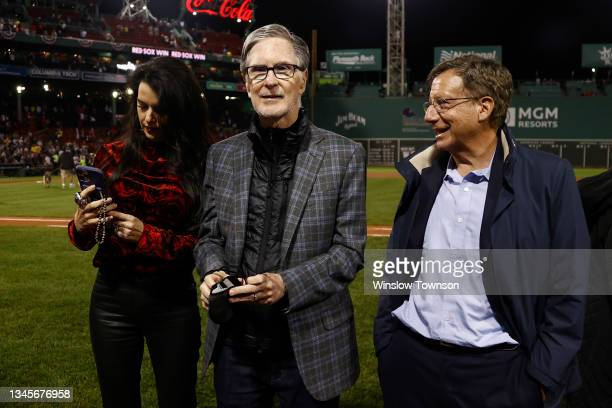 Boston Red Sox Principal Owner John Henry, his wife Linda Pizzuti Henry and Chairman Tom Werner after the AL Wild Card playoff game against the New...