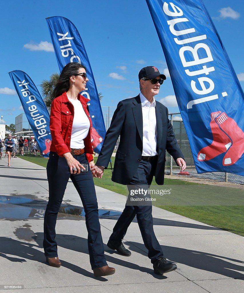 Boston Red Sox principal owner John Henry, right, and his wife Linda Pizzuti Henry walk the grounds on the day of the first full squad spring training workout at the Player Development Complex at Jet Blue Park in Fort Myers, FL on Feb. 19, 2018.