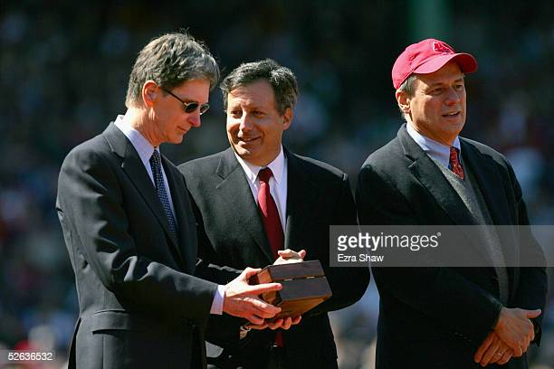 Boston Red Sox principal owner John Henry stands with Red Sox vice chairman Tom Werner and team president/CEO Larry Lucchino during a pregame...