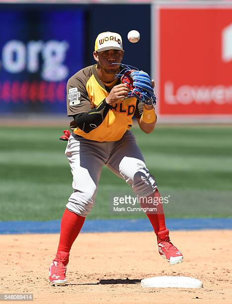 Boston Red Sox prospect Yoan Moncada of the World Team catches a baseball during pregame warm ups prior to the SiriusXM AllStar Futures Game at PETCO...