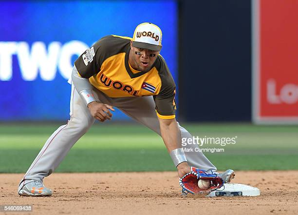 Boston Red Sox prospect Yoan Moncada of the World Team catches a baseball during the SiriusXM AllStar Futures Game at PETCO Park on July 10 2016 in...