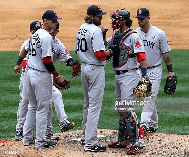 Boston Red Sox relief pitcher Andrew Miller got a job well done from Boston Red Sox catcher Jarrod Saltalamacchia after getting the job done in the...