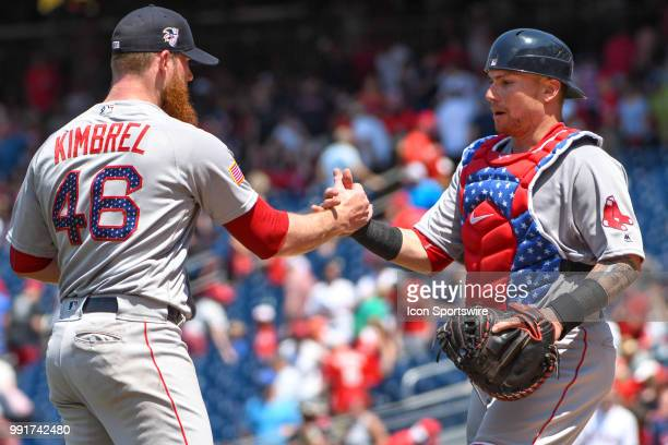 Boston Red Sox relief pitcher Craig Kimbrel is congratulated by catcher Christian Vazquez following the game between the Boston Red Sox and the...
