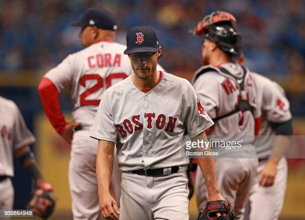 Boston Red Sox relief pitcher Joe Kelly heads for the dugout after being removed from the game by manager Alex Cora in the bottom of the eighth...