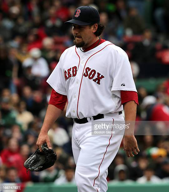 Boston Red Sox relief pitcher Joel Hanrahan walks the long walk to the Sox dugout amidst a round of boos from the stands after he was lifted in the...