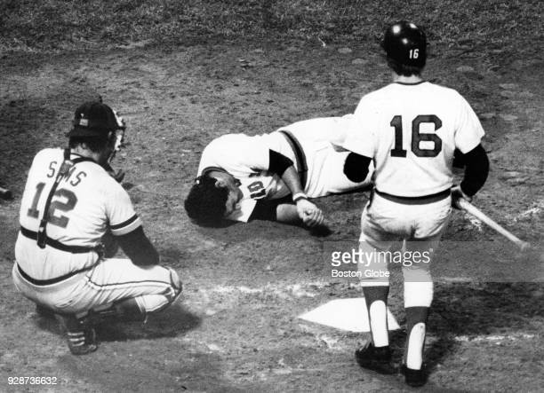 Boston Red Sox Rick Miller right rushes to the aide of Mario Guerrero center after he was hit on the wrist by Detroit Tigers Mike Strahler pitch at...