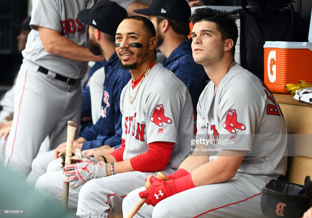 Boston Red Sox Right field Mookie Betts (50) and Boston Red Sox Left field Andrew Benintendi (16) look on from the dugout during a MLB game between the Minnesota Twins and Boston Red Sox on June 20, 2018 at Target Field in Minneapolis, MN. The Twins defeated the Red Sox 4-1.