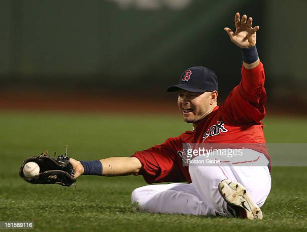 Boston Red Sox right fielder Cody Ross makes a sliding attempt but can't make the catch of a bloop fly to right by Toronto Blue Jays shortstop Yunel...