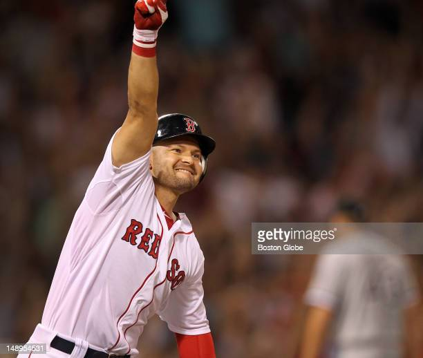 Boston Red Sox right fielder Cody Ross pumps his fist as he rounds first base after hitting a game winning three run home run in the bottom of the...