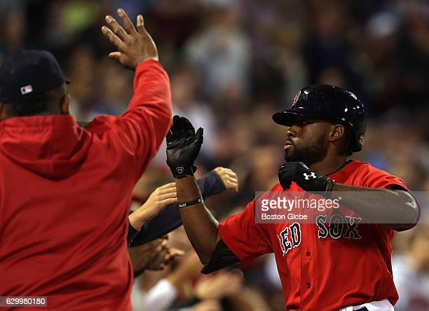 Boston Red Sox right fielder Jackie Bradley Jr. Is congratulated as he approaches the Sox dugout after hitting a solo home run in the seventh inning....