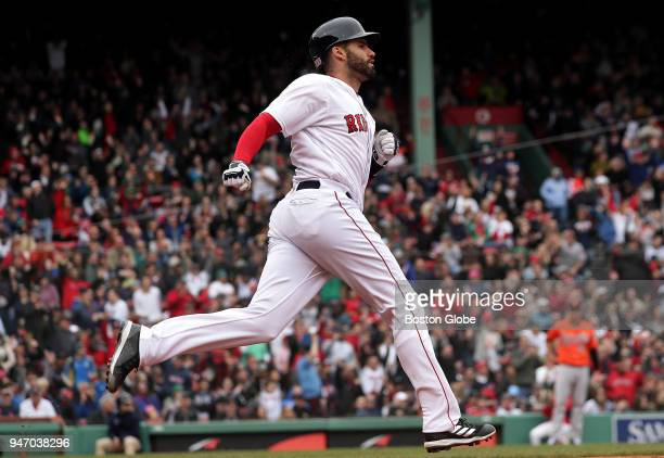 Boston Red Sox right fielder JD Martinez rounds first base after his solo home run in the third inning The Boston Red Sox host the Baltimore Orioles...