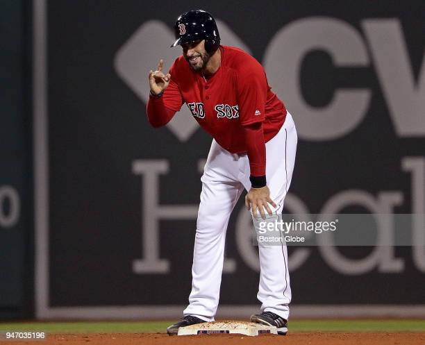 Boston Red Sox right fielder JD Martinez signals to the Sox dugout after his double in the sixth inning The Boston Red Sox host the Baltimore Orioles...