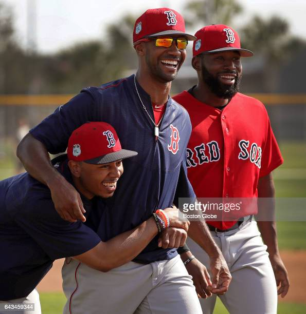 Boston Red Sox right fielder Mookie Betts Boston Red Sox outfielder Chris Young and Boston Red Sox center fielder Jackie Bradley Jr share a laugh...