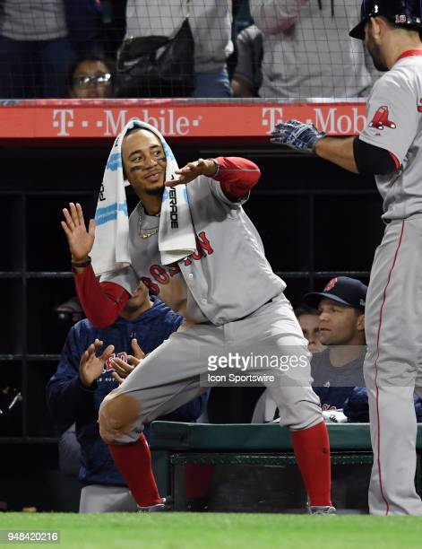Boston Red Sox right fielder Mookie Betts greets first baseman Mitch Moreland after Moreland hit a two run home run in the ninth inning of a game...