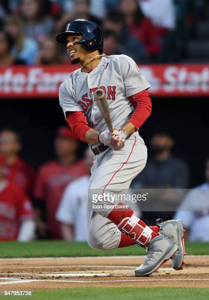 Boston Red Sox right fielder Mookie Betts hits a leadoff solo home run in the first inning of a game against the Los Angeles Angels of Anaheim played...