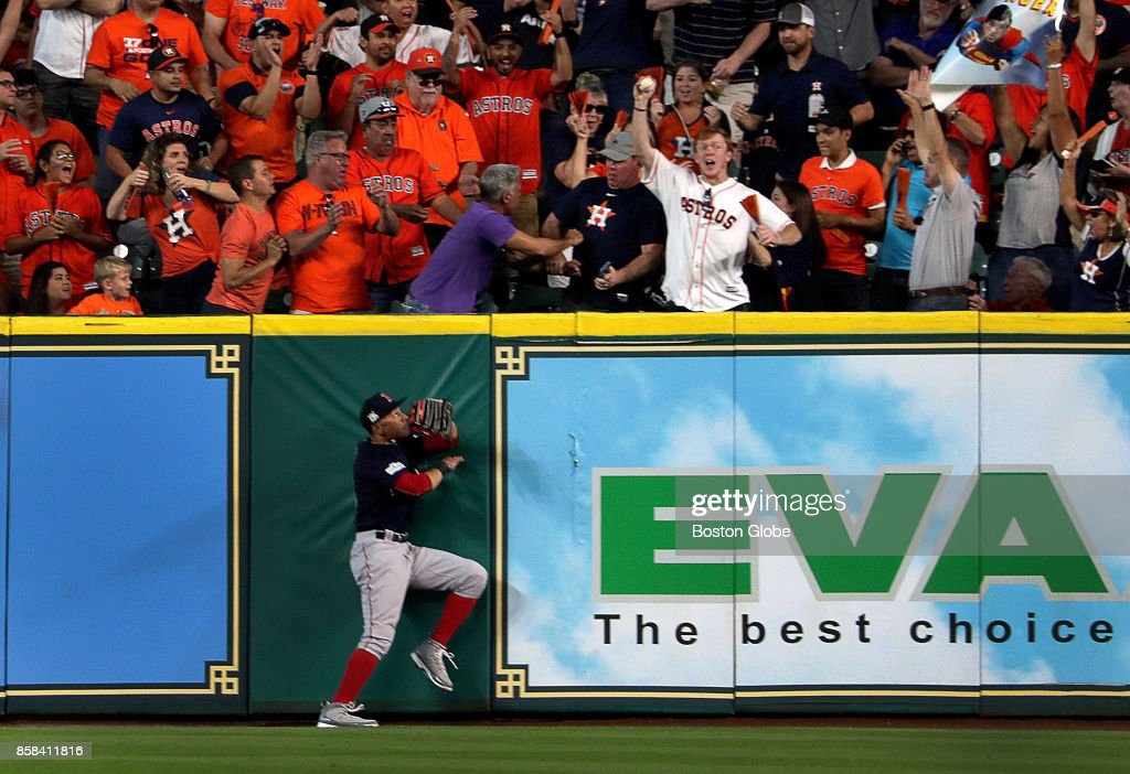 9caba8865 Boston Red Sox right fielder Mookie Betts hits the wall as a fan makes the  catch