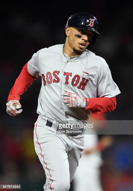 Boston Red Sox right fielder Mookie Betts rounds the bases after hitting a solo home run in the eighth inning of a game against the Los Angeles...