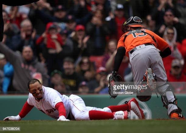 Boston Red Sox right fielder Mookie Betts slides safely into home plate during a threerun first inning The Boston Red Sox host the Baltimore Orioles...