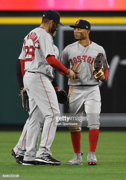 Boston Red Sox right fielder Mookie Betts with left fielder JD Martinez after the Red Sox defeated the Los Angeles Angels of Anaheim 9 tom0 in a game...