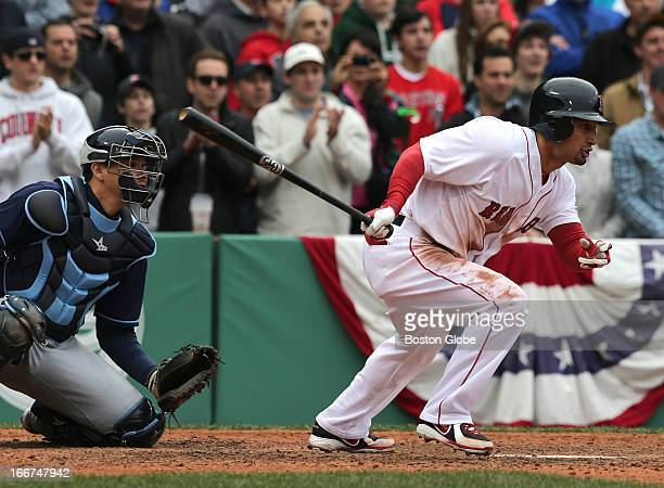 Boston Red Sox right fielder Shane Victorino hits the game winning RBI single to drive in the winning run in the tenth inning as the Boston Red Sox...