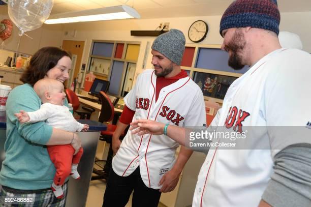 Boston Red Sox Robby Scott and Austin Maddox visit Gabriella and her mom at Boston Children's Hospital December 14 2017 in Boston Massachusetts