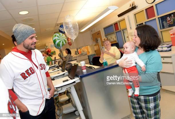 Boston Red Sox Robby Scott says hi to Gabriella and her mom at Boston Children's Hospital December 14 2017 in Boston Massachusetts